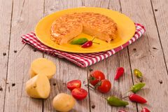 Spanish omelette. Spanish omelette with chorizo and chilli peppers stock photos