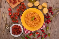 Spanish omelette. Spanish omelette with chorizo on wooden table royalty free stock photos