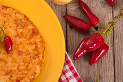 Spanish omelette. Spanish omelette with chorizo on wooden table stock images