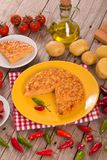 Spanish omelette. Spanish omelette with chorizo on wooden table stock photos