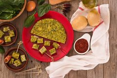 Spanish omelette with spinach. Spanish omelette with spinach with smoked ham royalty free stock photos