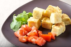 Spanish omelette with tomato Stock Images