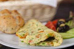 Spanish Omellete. In cuisine, an omelette or omelet is a dish made from beaten eggs quickly cooked with butter or oil in a frying pan, sometimes folded around a royalty free stock photo