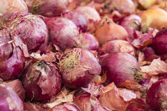 Spanish onions on a market stand. Close-up of Spanish onions on a market stand in Greece Stock Photos