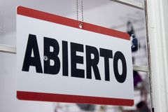 Close-up of an open sign in spanish. `Abierto` stock photo