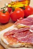 Spanish pa amb tomaquet with serrano ham Stock Photography