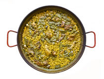 Spanish Paella. Spanish typical paella isolated on a white background. Home made Royalty Free Stock Images
