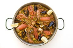 Spanish paella. Served on a dish with a white background Stock Photos