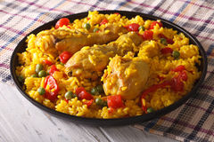 Spanish paella with chicken closeup on a plate. horizontal stock images