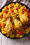 Spanish paella with chicken and vegetables closeup. vertical top Stock Photo