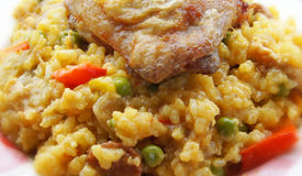 Spanish Paella and Golden Fried Chicken thigh Royalty Free Stock Photography