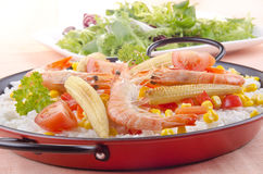 Spanish paella with organic vegetables. Spanish vegetable paella with bell pepper, babycorn and tomato Stock Photography