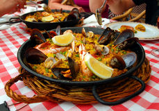 Spanish paella in the pan. Spanish paella with seafood in the pan royalty free stock photo