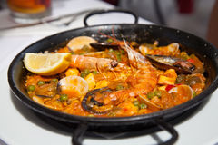 Spanish Paella. Seafood Paella in black pan -traditional spanish rice dish Royalty Free Stock Photography