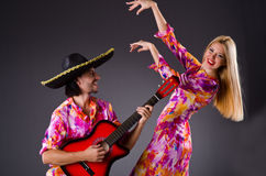 Spanish pair playing guitar Royalty Free Stock Photos