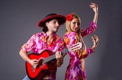 Spanish pair playing guitar Stock Images