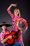 Spanish pair playing guitar Stock Photo