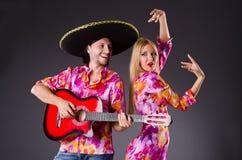 Spanish pair playing guitar Stock Photo