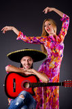 Spanish pair playing guitar Stock Images
