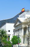 Spanish parliament. Classic, greek type, entrance to Spanish Parliament with modern anex building of administration in background and palm tree in fordward view Stock Photos