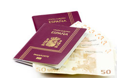 Spanish passport with european union currency banknotes Royalty Free Stock Image