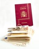 Spanish Passport, keys, money. Spanish, Passport, keys, money on a white background Royalty Free Stock Photo