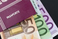 Spanish passport with money dollars royalty free stock photography