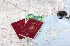 Spanish passports with european union currency and glasses on a Stock Photos