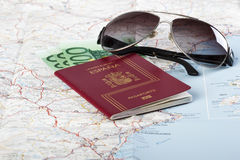 Spanish passports with european union currency and glasses on a Royalty Free Stock Images