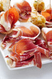 Spanish pinchos, spanish tortilla and serrano ham served on brea Royalty Free Stock Photography