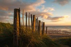 Spanish Point Sunset Fence. Spanish Point Sunset West Clare Ireland Sunset Wild Atlantic Way Golden Sky Timber Fence Stock Photography