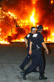 Spanish Police Attend Scene of Fire. Two Spanish Police Officers attend scene of fire which was in fact a controlled event during the burning of effigies as part Royalty Free Stock Images