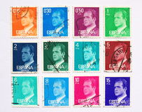 Spanish postage stamps. Used postage stamps from the 1970s in 12 different colors and values, with the portrait of the Spanish king Juan Carlos Royalty Free Stock Photo