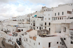 Spanish Pueblo on a cloudy day. Tightly packed pueblo in Spain that is in need of repair Stock Photo