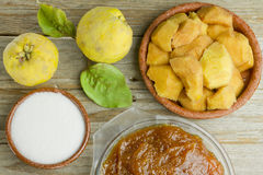 Spanish quince paste with ingredients. Spanish quince fruits and paste with ingredients on wooden background Royalty Free Stock Image