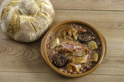 Spanish red bean stew with eartheOlla podrida, spanish red bean stew with chorizo, pig and blood sausage with earthnware casserole Stock Image