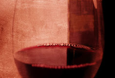 Spanish red wine Glass with bubbles and bottle on grunge arty background Royalty Free Stock Image