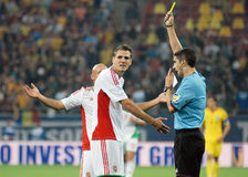 Spanish referee Alberto Undiano Mallenco shows yellow card in Romania-Hungary Stock Photography