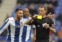 Spanish Referee Clos Gomez delivers yellow card Royalty Free Stock Photography