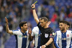 Spanish Referee Clos Gomez delivers yellow card Royalty Free Stock Images
