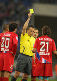 Spanish Referee Fernandez Borbalan. Referee Fernandez Borbalan delivers yellow card to Cortes of Getafe in a Spanish League match against RCD Espanyol at the Stock Image