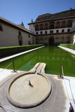 Spanish Reflecting Pool. Fountain and green reflecting pool in the Generalife of Granada's La Alhambra with hedges and surrounded by traditional Andalusian royalty free stock images