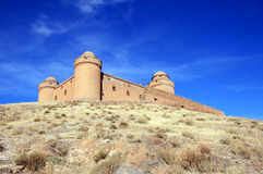 Spanish renaissance haunting Castle of Calahorra. Looming over the village of La Calahorra and the plateau of the Marquesado in the northern foothills of the Stock Photography