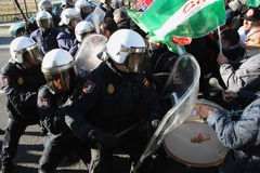 Spanish riot police clash with protestors. Spanish riot police charge against municipal workers in the town of La Linea, near Gibraltar Stock Photos