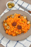 Risotto with tomatoes, olives and chorizo Royalty Free Stock Images