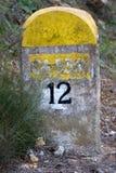 Spanish Road Marker Km 12. Spanish milestone road marker on a secodary road to the sierra de cadiz stock images