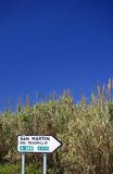 Spanish roadsign next to reeds and bullrushes in Spain royalty free stock image