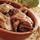 Spanish roast rabbit. Closeup of an earthenware bowl with spanish roast rabbit Stock Photo