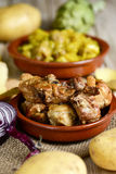 Spanish roasted chicken and rabbit Stock Photos