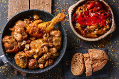 Spanish roasted chicken, rabbit and vegetables Stock Image
